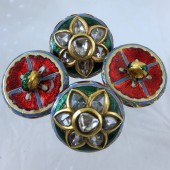 Four enamelled gold buttons with dimonds